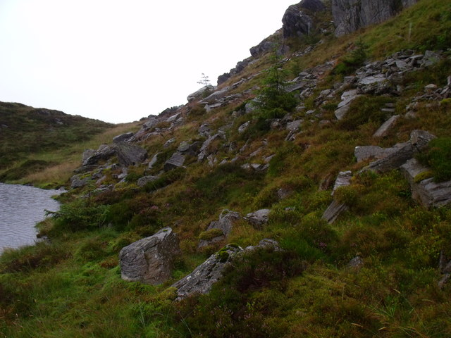 Gloomy rock wall above Binnean nan Gobhar's lochan