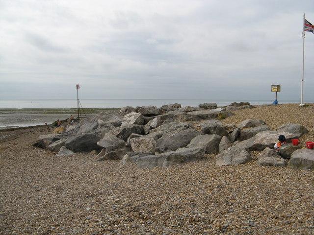 Sea defence rocks by Sea Lane cafe