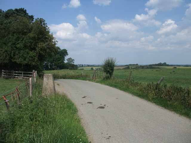 Cycle Route 6 passing the trig point on the road from Gumley to Saddington