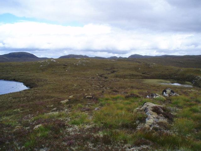 Small lochans on  Meall nan Aighean plateau