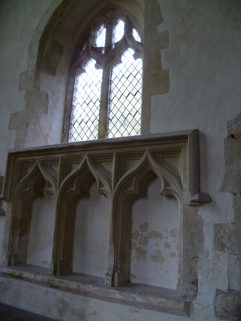 Niches in chancel wall of Poynings church