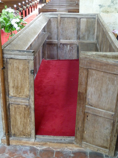 Enclosed and carpeted pew in Poynings church