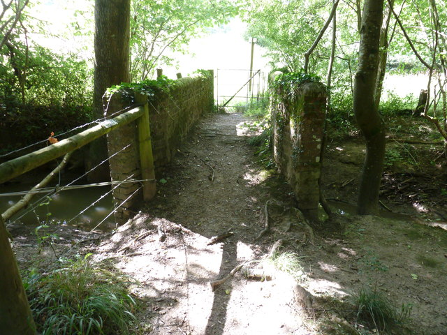 Old brick footbridge over Cockhaise Brook on the edge of Brookhouse Wood