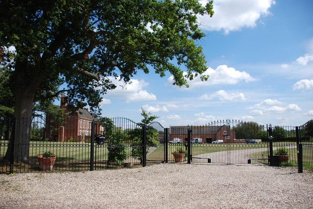 Through Gates to Large Mansion