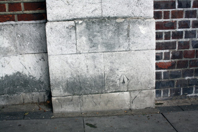 Benchmark on wall pier on NE side of Park Road
