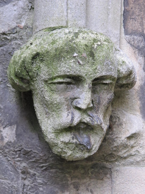 Stone head by the entrance to St. Peter's Church, Belsize Park / Belsize Square, NW3