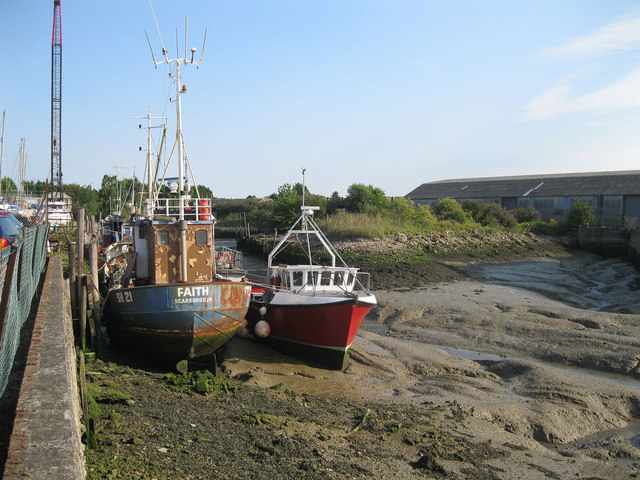 Boats aground at Otterham Creek Boatyard