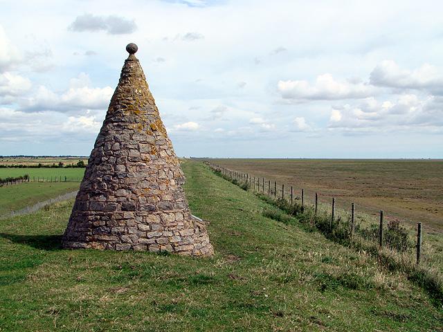 Monument on the sea bank near North Sea Camp Prison