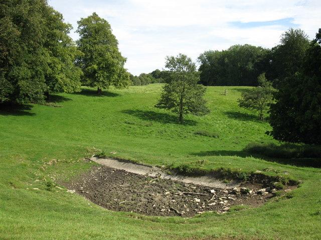 Dry pond on the hillside at Dyrham Park