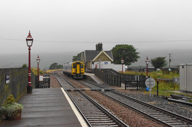Train passes Ribblehead Station
