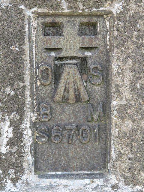 Bench mark on the trig point on Warlaw Pike