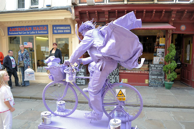 Side view of purple cyclist