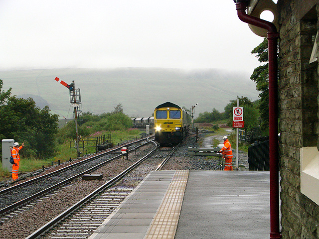 A coal train approaches Garsdale station