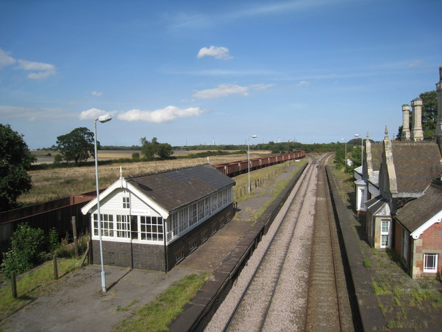 A train of empty iron ore wagons takes the Ulceby line at Brocklesby Junction