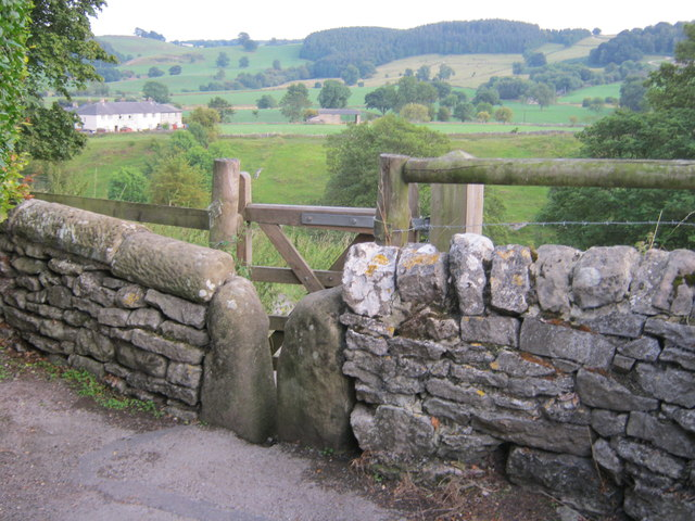 Stone stile and gate for footpath down to the Limestone Way in Youlgrave