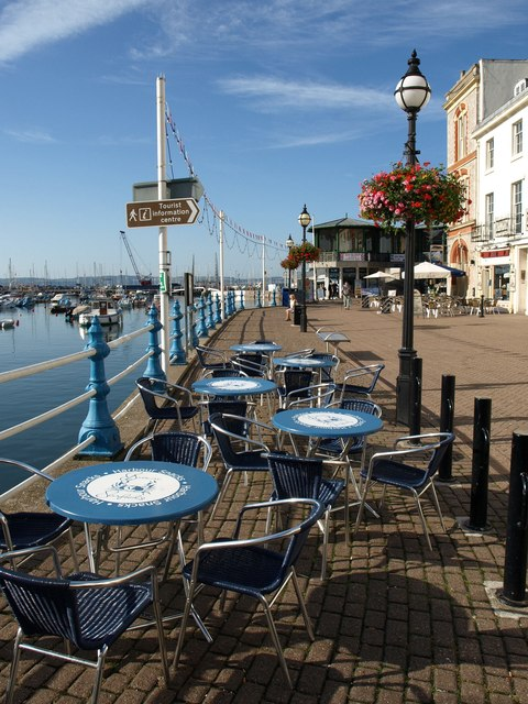 Tables by Torquay harbour