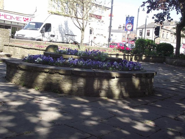 Small paved area and flower bed, near Mirfield Library
