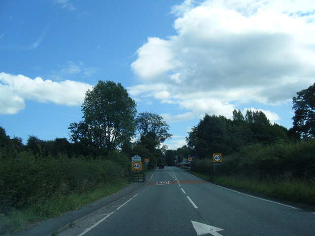 Chelford Road and Henbury village sign
