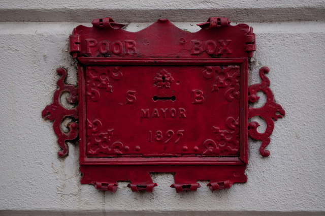 A poor box on the wall of the Guildhall in Butchers Row
