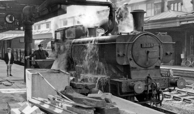 An '8750' standard 0-6-0PT taking water at Shrewsbury station