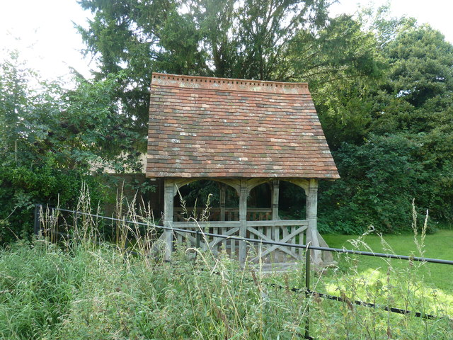 Former Lych Gate used as shelter in corner of grave yard