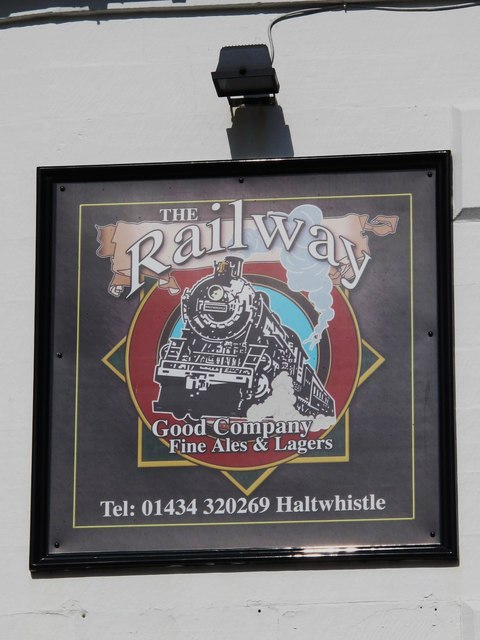 Sign for The Railway, Station Road