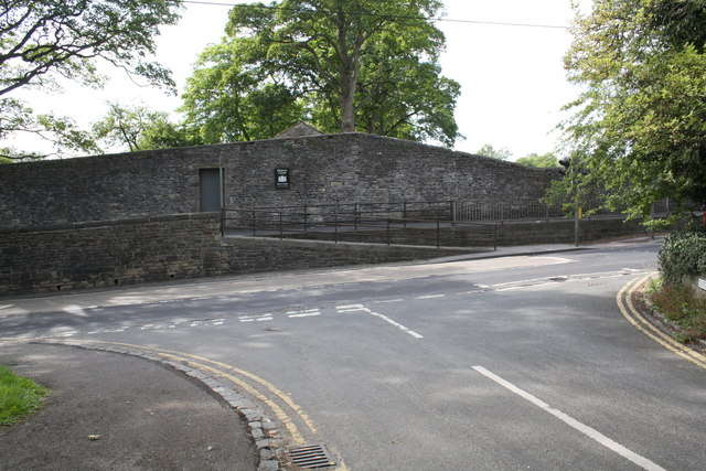 Castle wall on The Bailey at junction with Overdale Court