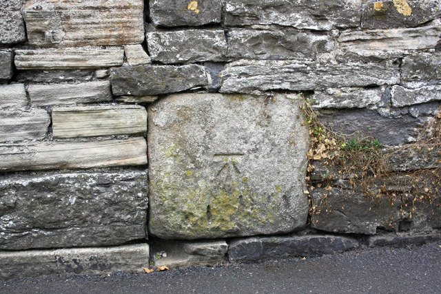 Benchmark on stone in wall of The Bailey opposite Overdale Court