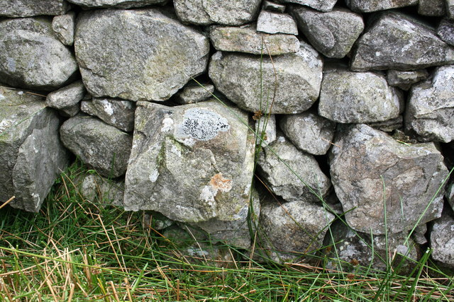 Benchmark on stone in wall at Birk Shaw