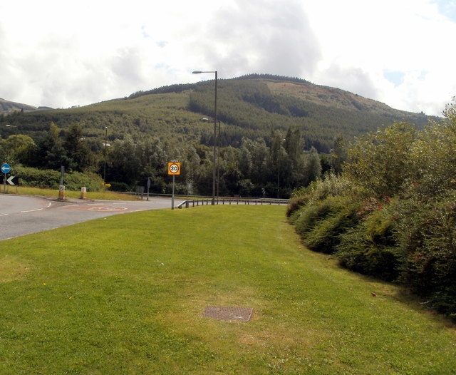 Edge of a roundabout and a hillside view near Glynneath