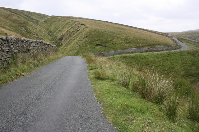 Road and dry stone wall near Swere Gill Bridge
