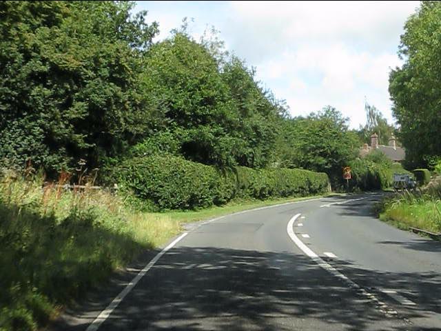 Sharp bend on the A4117 entering Stoneylane