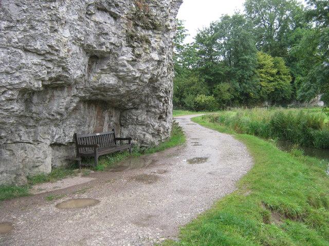 Seat under Limestone cliff in Bradford Dale