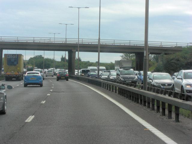 M4 bridge carries Riding Court Road