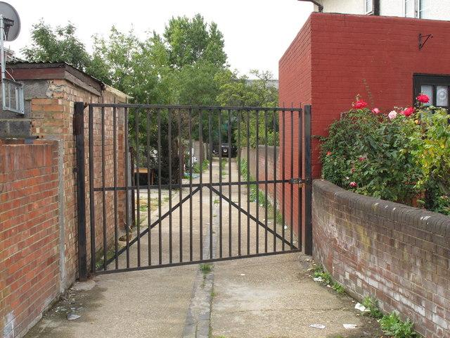 Gated alley behind Horn Lane shops
