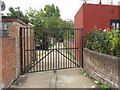 TQ2081 : Gated alley behind Horn Lane shops by David Hawgood