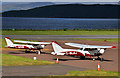NM9035 : Two aircraft - Oban Airport by TheTurfBurner