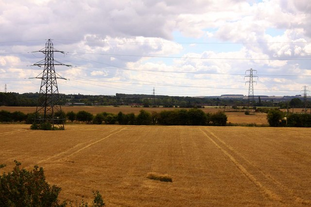 Harvested fields under the wires