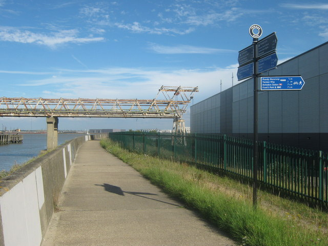 Footpath junction on the Thames Path near Warehouse on Norman Road