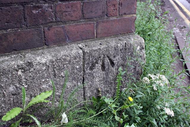 Benchmark on railway bridge abutment, London Road
