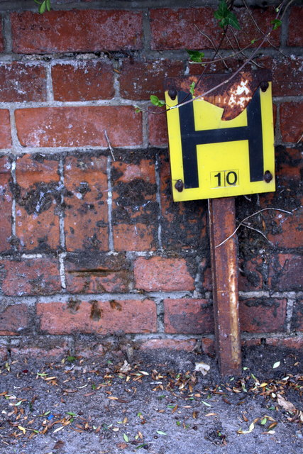 Benchmark on wall at junction of Wokingham Road and Crescent Road