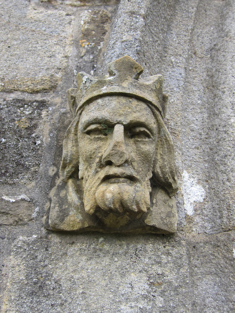 Carved stone male head on St James' porch