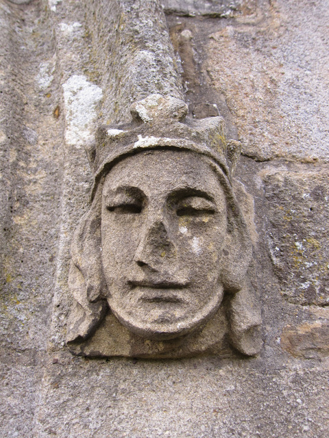 Carved stone female head on St James' porch
