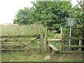 SE3938 : Stile and notice, Leeds Country Way by Derek Harper