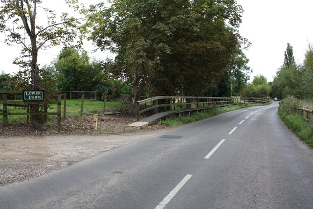 Raised footway on road outside Lower Farm