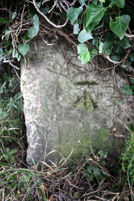 Benchmark on concrete block beside road