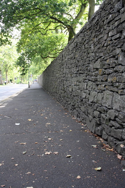 Wall and pavement on west side of The Bailey