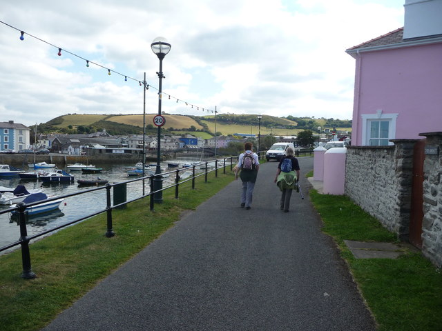 Walkers beside the harbour in Aberaeron