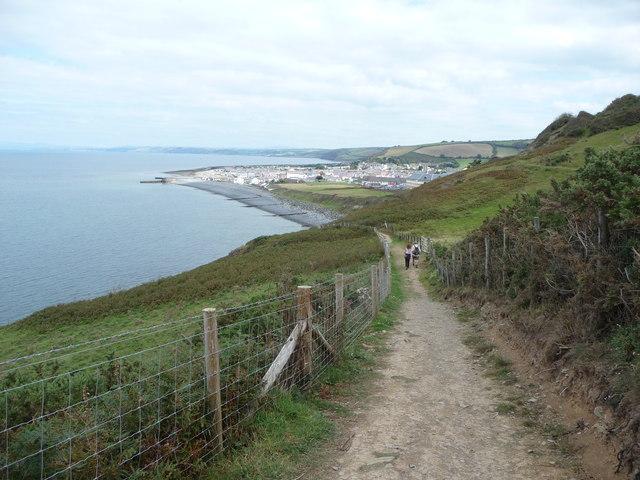 A couple walking on the Ceredigion Coast Path above Aberaeron