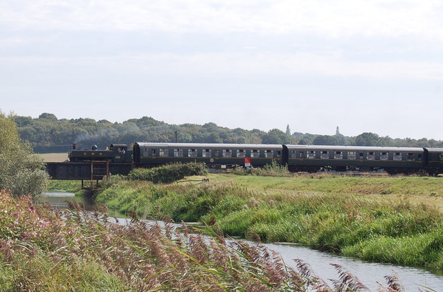 Steam Train crosses the river Rother
